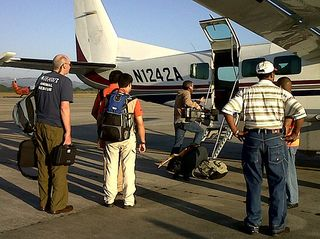 Boarding plane to port au prince